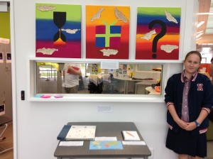 Paton and her artwork of present, past and future self..